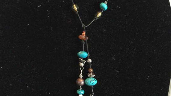 leather lariat necklace with turquoise ,carnelian,smokey topaz and silver.