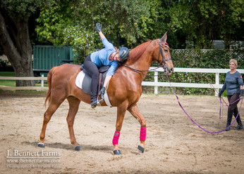 Leah and Miracle in an advanced lesson