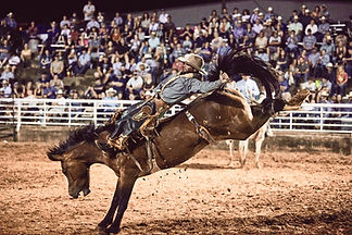 Will Lowe riding at the Hood County Stampede charity rodeo