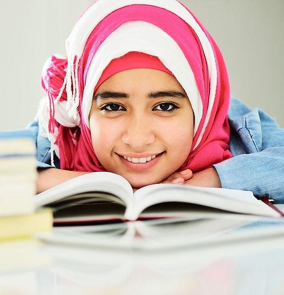 Happy-Muslim-girl-studying.jpeg