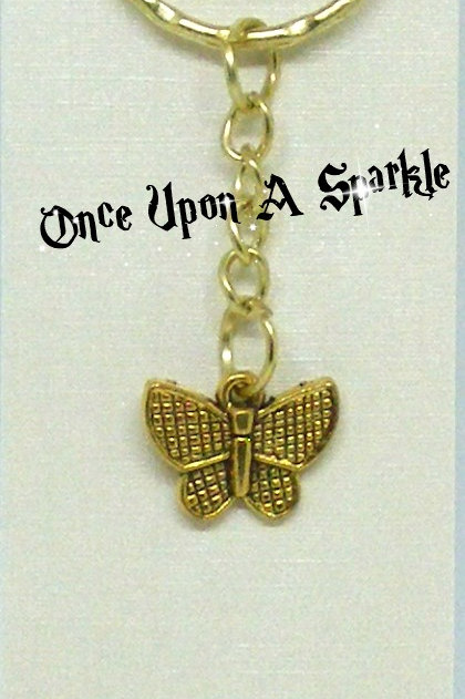 gold toned key ring with antique gold butterfly charm
