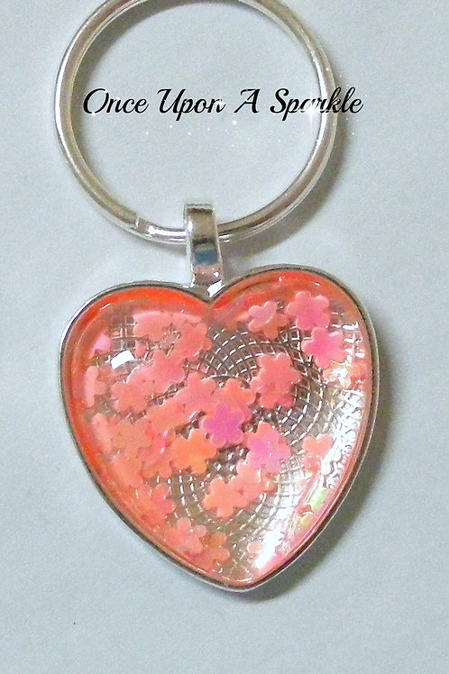 coral pink flower glitter on silver bezel tray with dome