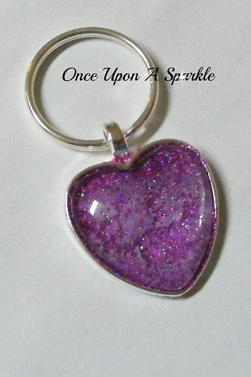 purple glitter in silver bezel tray under dome
