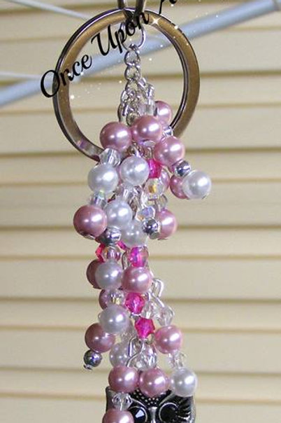 sparkly AB owl with shades of pink & white pearl beads with sparkle