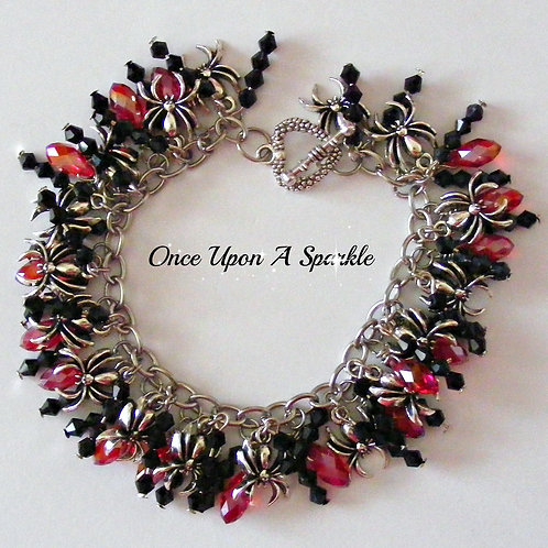 weird and wonderful silver spiders with black & red sparkly beads