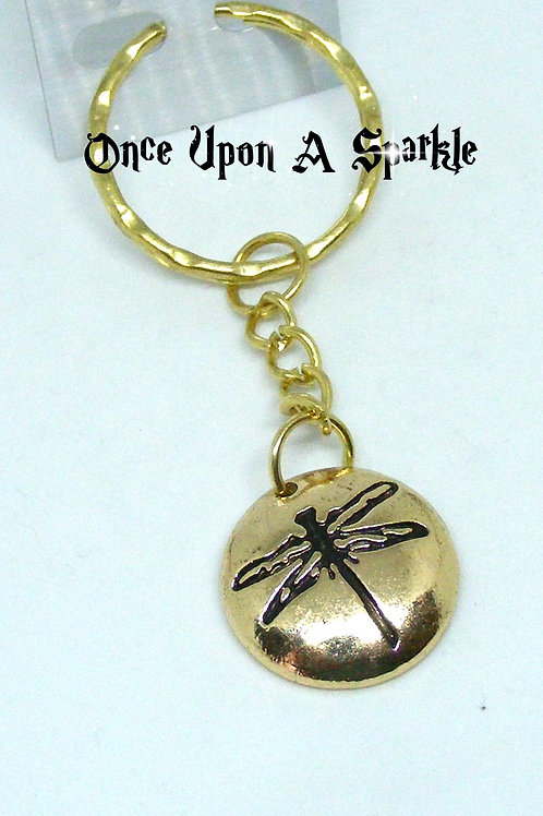 Black etched dragonfly on gold tone key ring