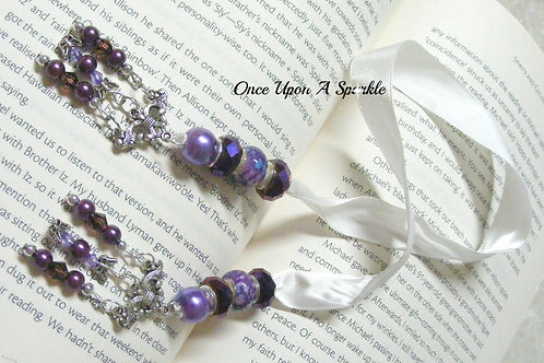 white ribbon bookmark with purple beads and dangles