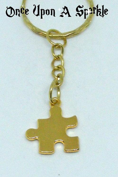 gold tone jigsaw piece key ring