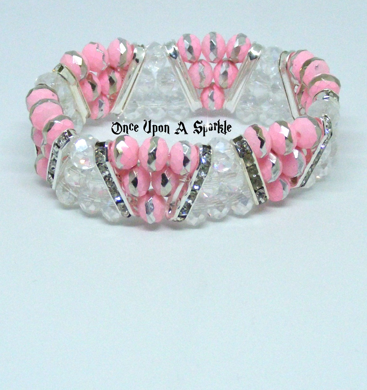 Bracelet stretch triangle pale pink with clear