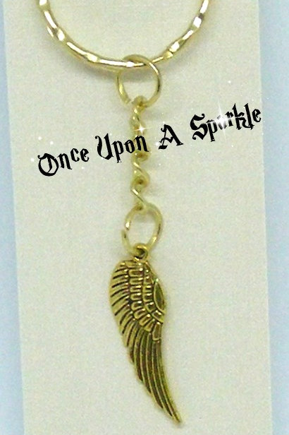 gold toned key ring with antique gold Angel Wing