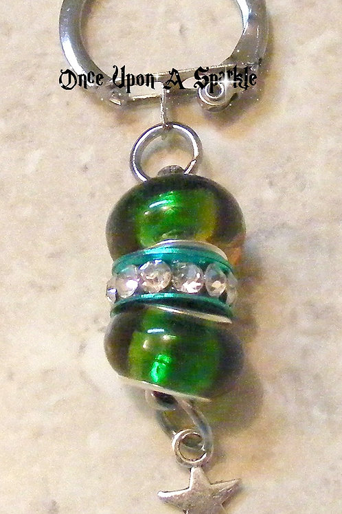 green and orange beads with antique silver star charm