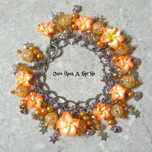 Champagne beads with bright orange frangipani