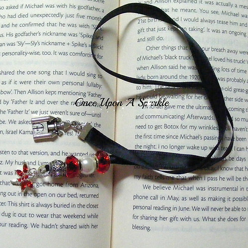 black ribbon bookmark with red dragonfly & castle