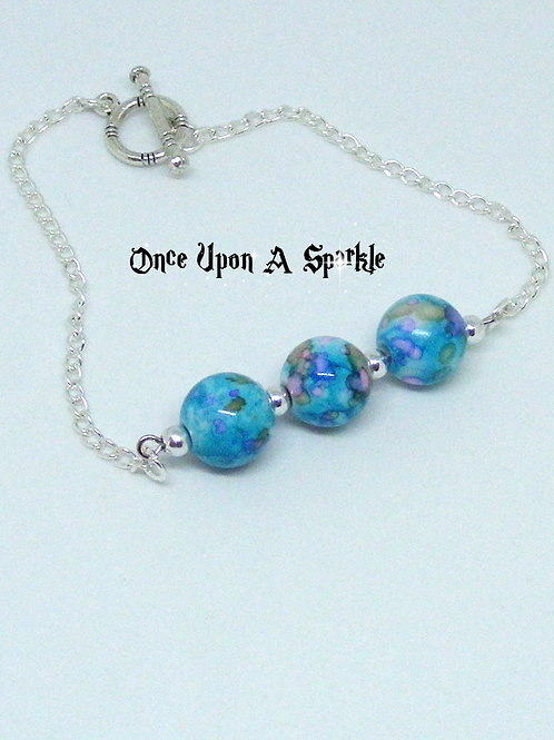 Silver Plated chain bracelet with 3 painted blue glass beads