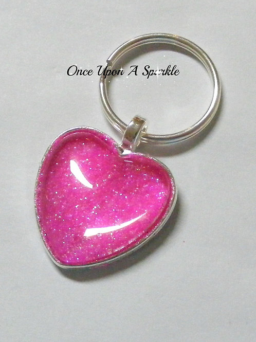 pretty hot pink sparkly glitter in silver bezel tray under dome