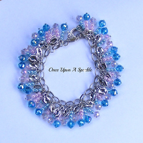 delicate pinks and blues with silver baby feet charms