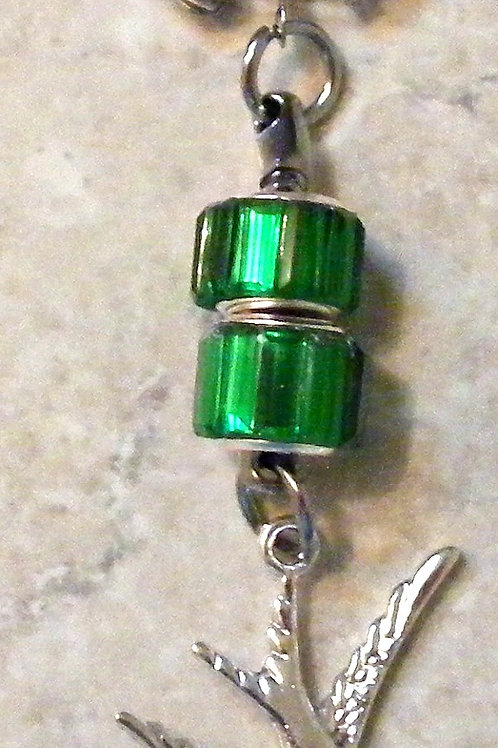 Green cord beads with silver bird charm