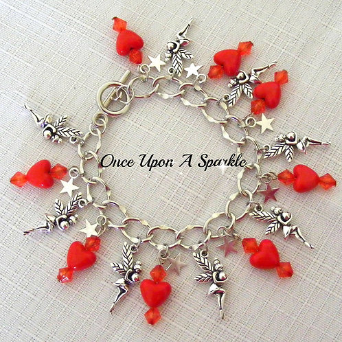 red hearts sparkly beads and antique silver fairies