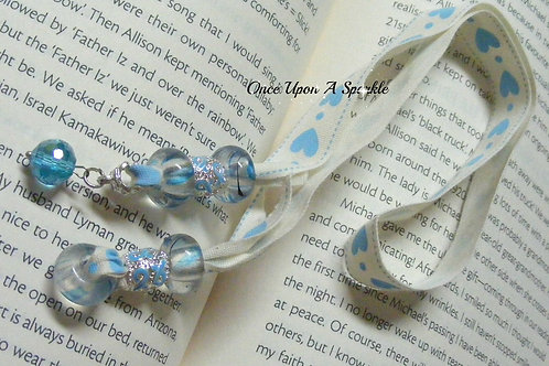 cream ribbon with blue hearts