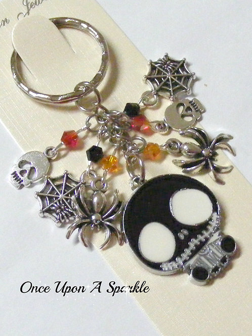 Halloween design with skulls spiders webs and some sparkle beads