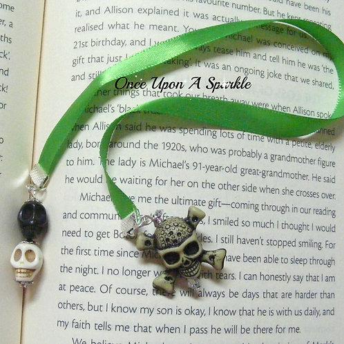 green ribbon bookmark with skulls