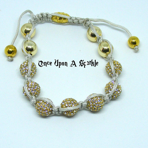 Grey cord with gold and sparkly disco ball beads