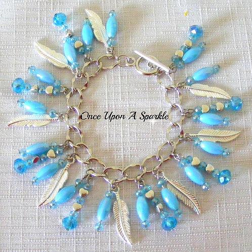 aqua rice beads sparkly aqua beads & silver feathers