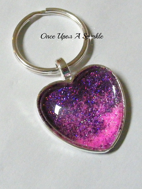 purple shades to pink glitter in silver bezel tray under dome