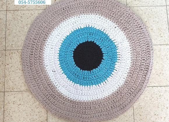 """שטיח סרוג בחוטי טריקו דגם """"עין"""""""