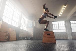Woman Doing A Box Squat At The Gym.jpg