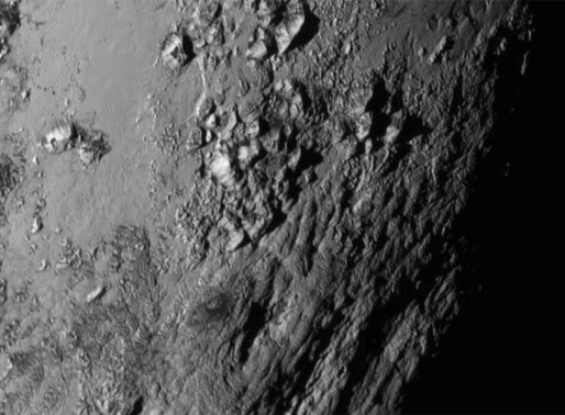 The Mountains and Makeup of Pluto