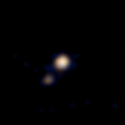 The First Color Photos of Pluto and Charon
