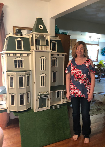 Charlene with our Bayside Mansion.jpg