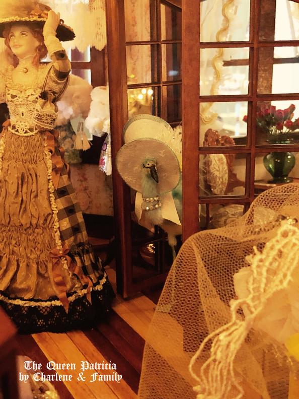 Adelina peeking in boutique.JPG