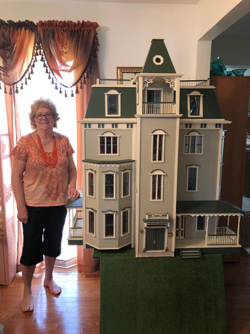 Mom with our Bayside Mansion.jpeg