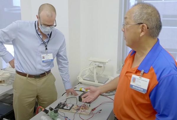 David Lizdas and Sem Lampotang working on the ventilator