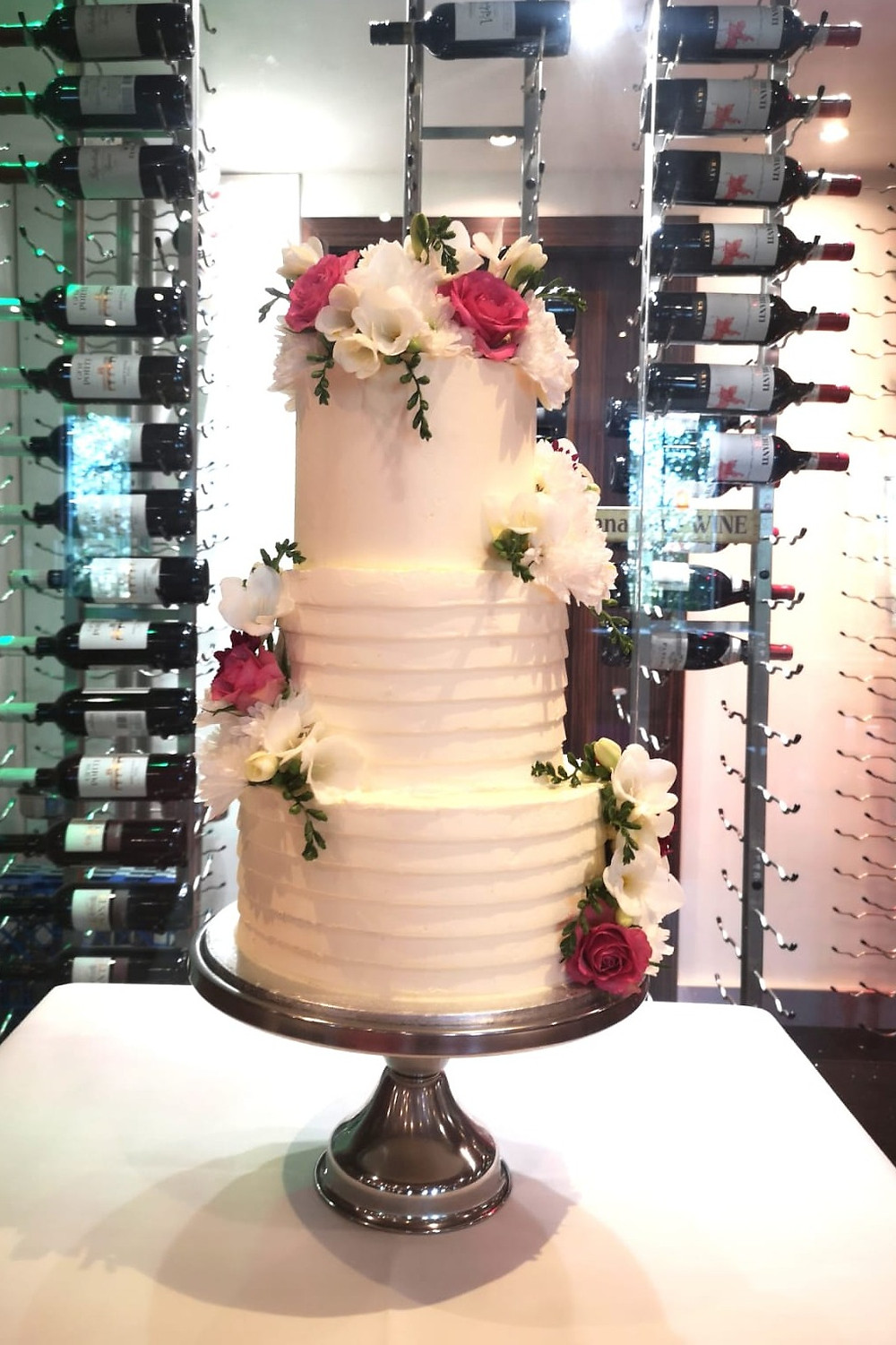 A Tall Wedding Cake for a Small Wedding but the rest of the cake can be frozen for later