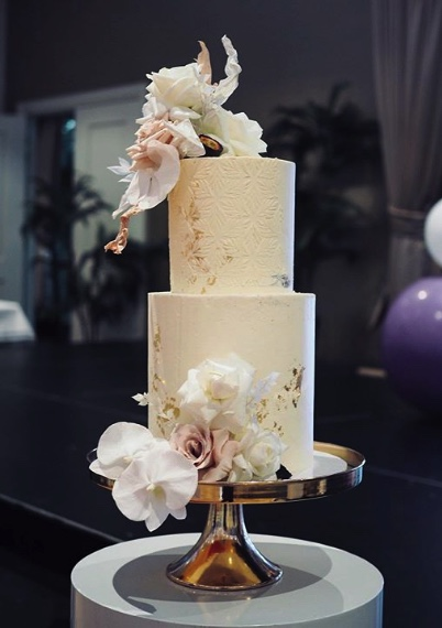 Beige Wedding Cake with lilies and gold flake