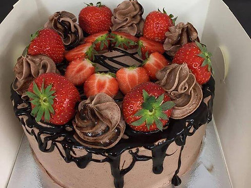 Chocolate Cake Decorated with Strawberries and Chocolate Drip
