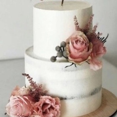 Beautiful Slightly Naked Wedding Cake with Pink Floral Arrangement