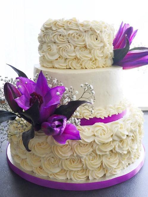 Purple & white 3-layer wedding cake in Ireland with purple flower