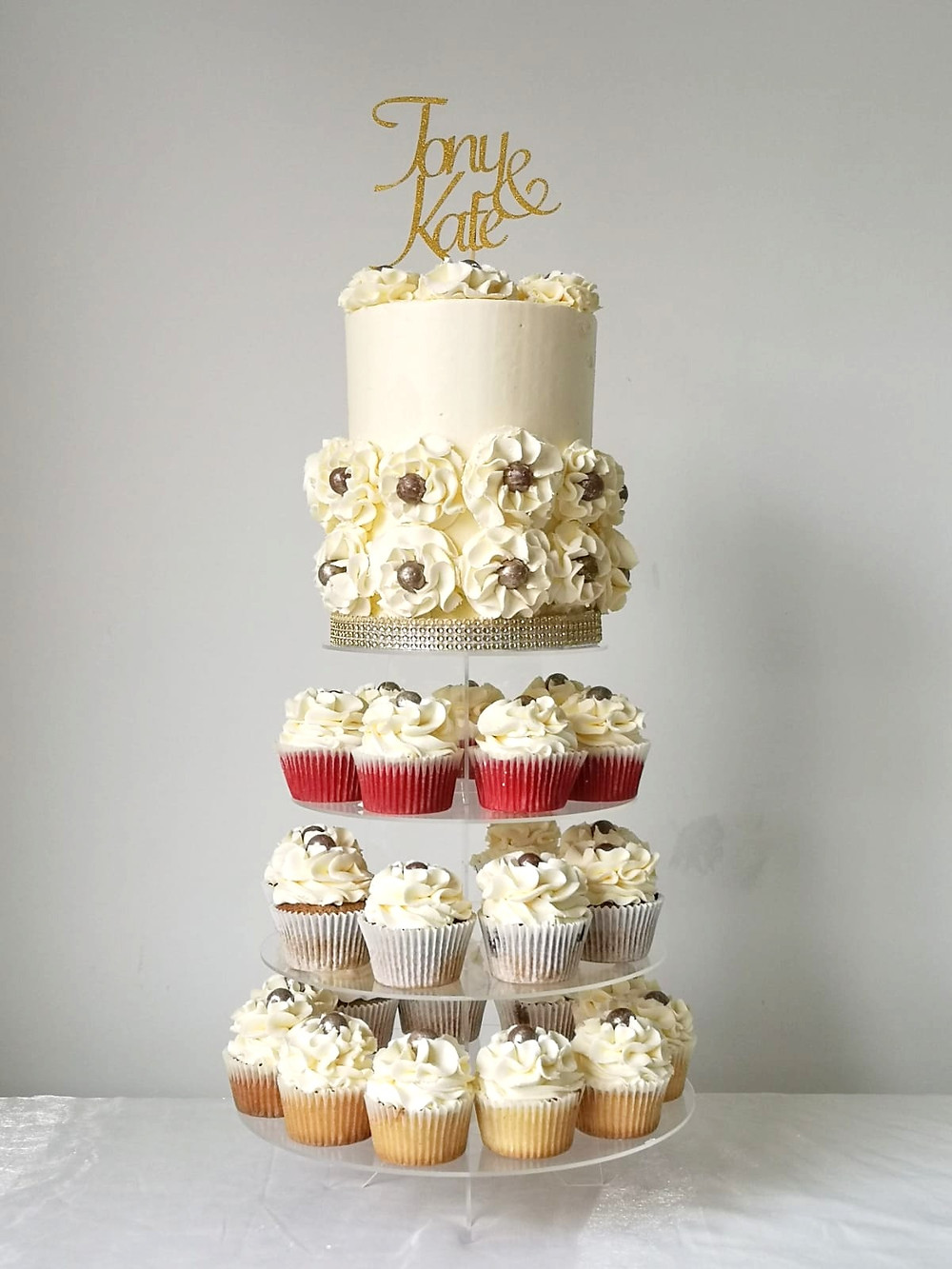 Wedding Cupcake Tower with a Small Cake