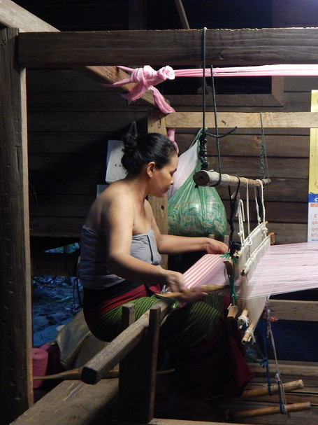 Weaver at Siam Niramit, Bangkok, Thailand