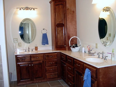 Corner vanity with two sinks