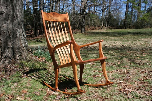 Cherry rocking chair with walnut accents and lumbar support