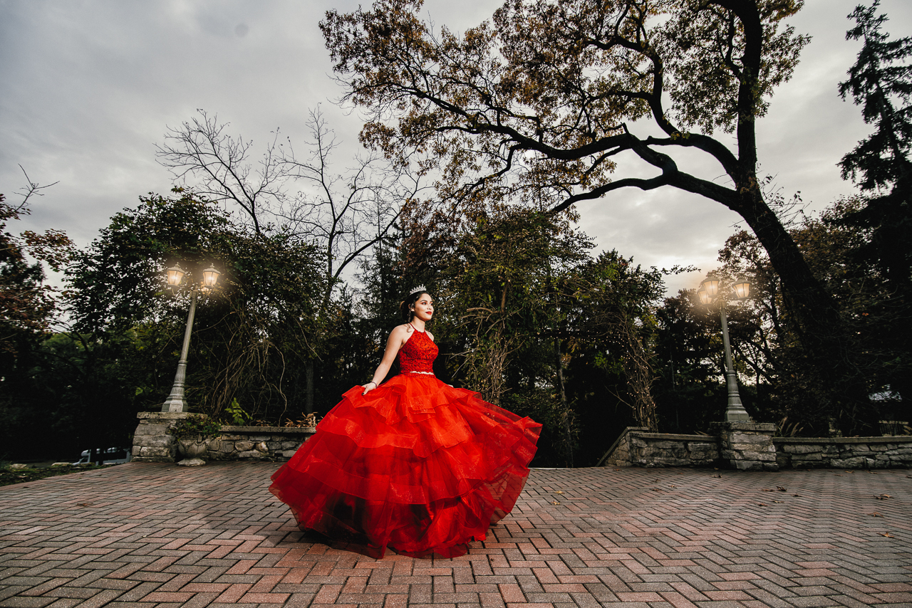 photo of quinceanera with red dress