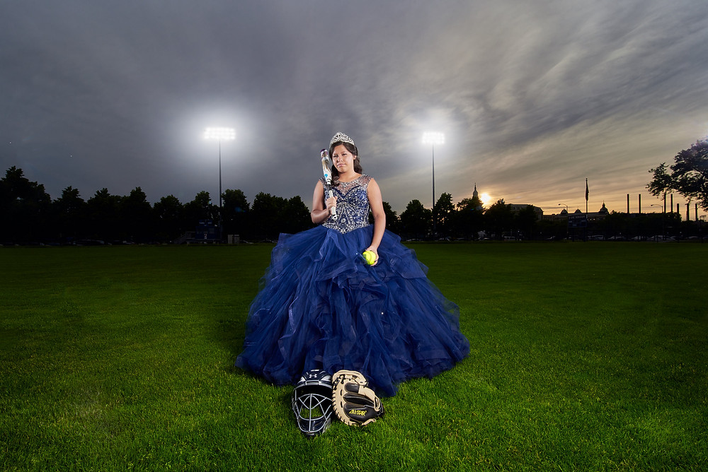 quiceanera wearing her dress and fastpitch gear themed photoshoot