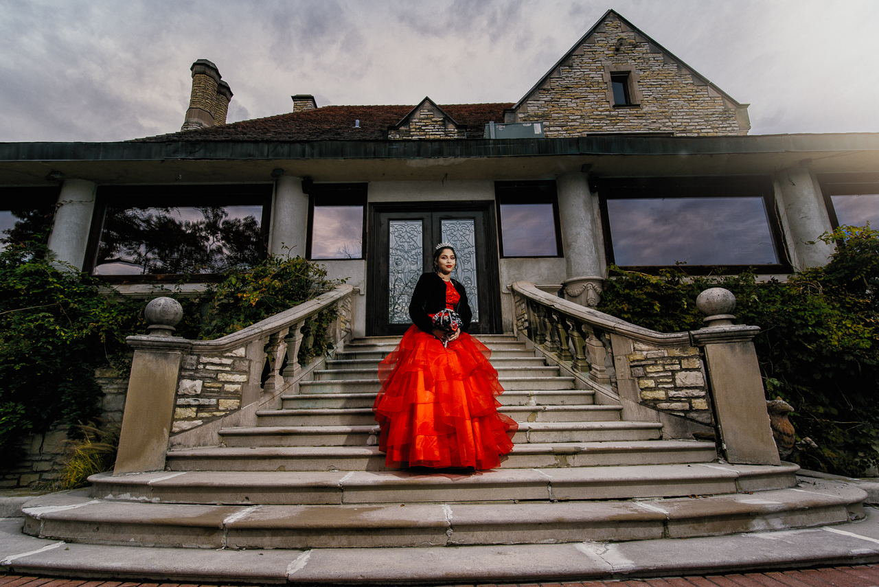 photo of quinceanera in red dress