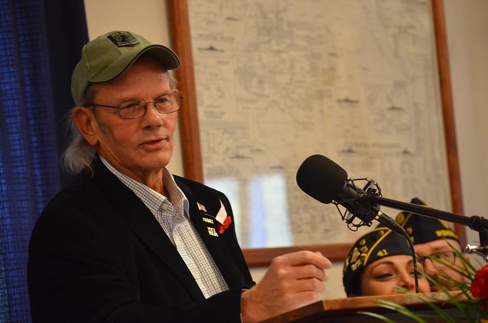 Guest speaker Rick Baird tells a few stories on John.