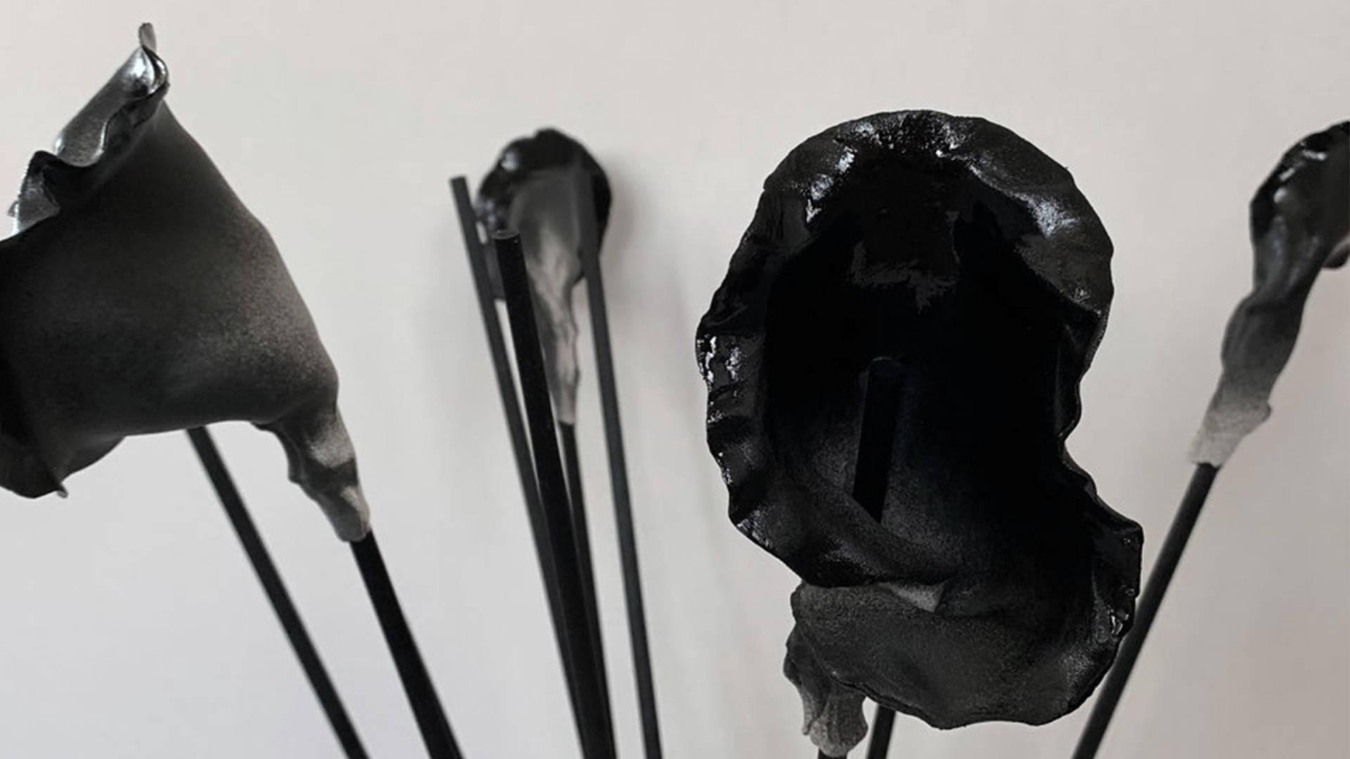 R as a Black Water Vase